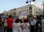 citizens of Madrid protesting with placards