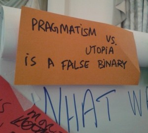 sign saying 'pragmatism versus utopia is a false binary'