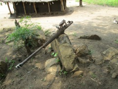 South Sudan gun in front of hut