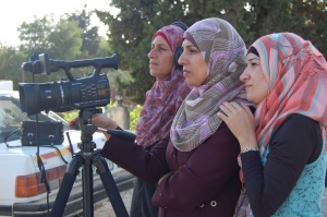Palestinian women filming