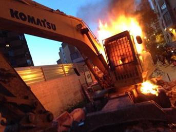 The bulldozer burning on the night of the 27 May 2014